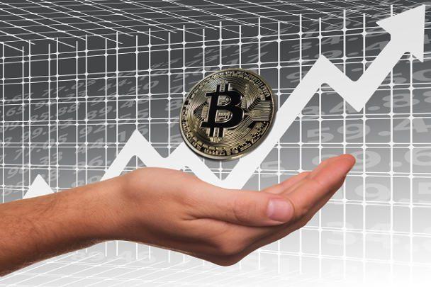Bitcoin rising hand